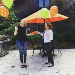 Nichole and Lindsey celebrate a work anniversary