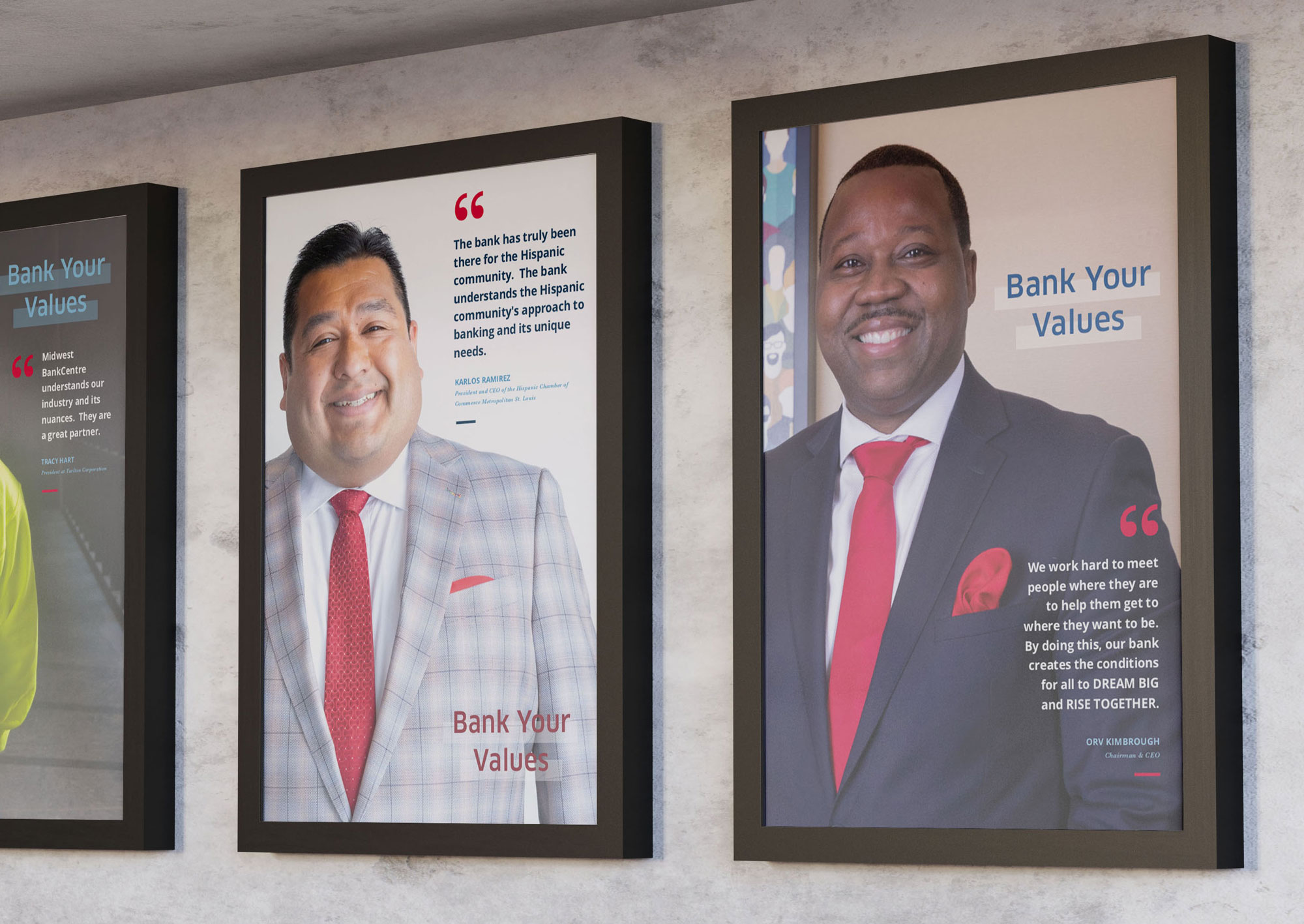 Posters of featured employees on a wall